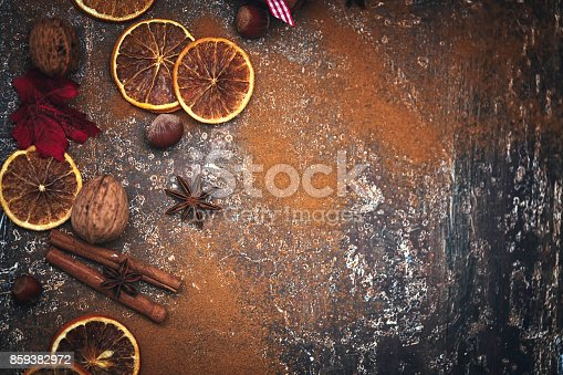 istock Autumn Background with Nuts, Spices and Candied Oranges 859382972