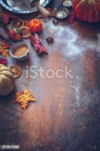 istock Autumn Background with Nuts, Spices and Candied Oranges 870875086