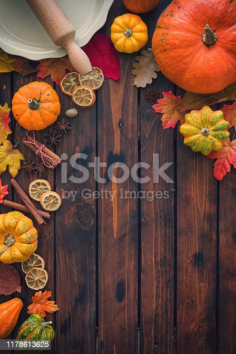 Autumn background with pumpkins, spices and candied oranges