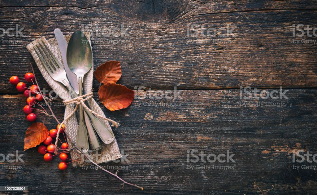 Autumn background with vintage place setting on old wooden table stock photo