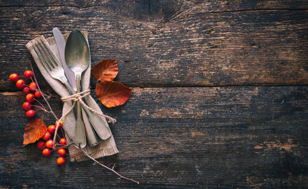 autumn background with vintage place setting on old wooden table - thanksgiving стоковые фото и изображения