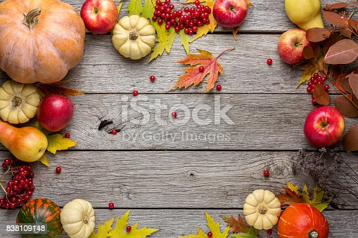 istock Autumn background with yellow leaves and pumpkins 838109148