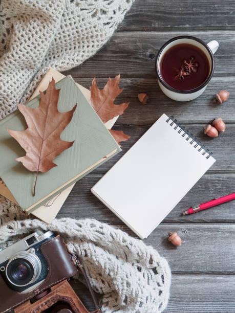 autumn background wooden table knitted shawl, camera, oak leaves notepad - folha de caderno imagens e fotografias de stock