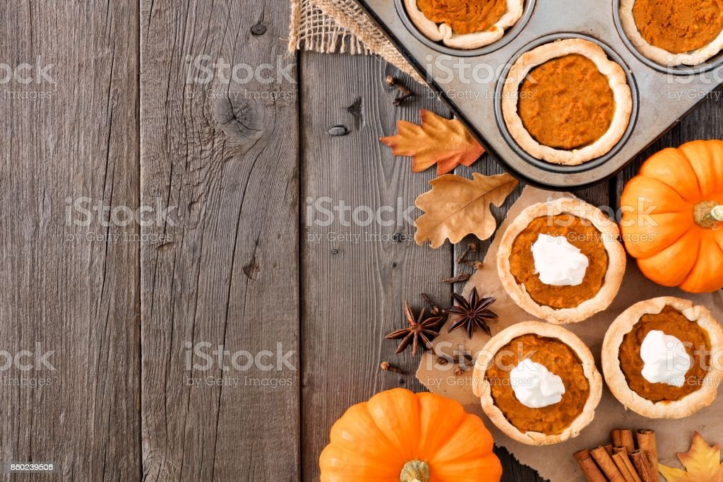 Autumn baking side border with pumpkin tarts over wood royalty-free stock photo