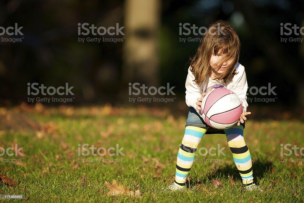 Autumn basketball with a toddler girl stock photo