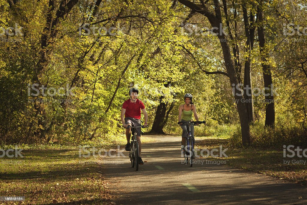 Autumn Bicyclists Exercising in Park Bicycle Path Hz royalty-free stock photo