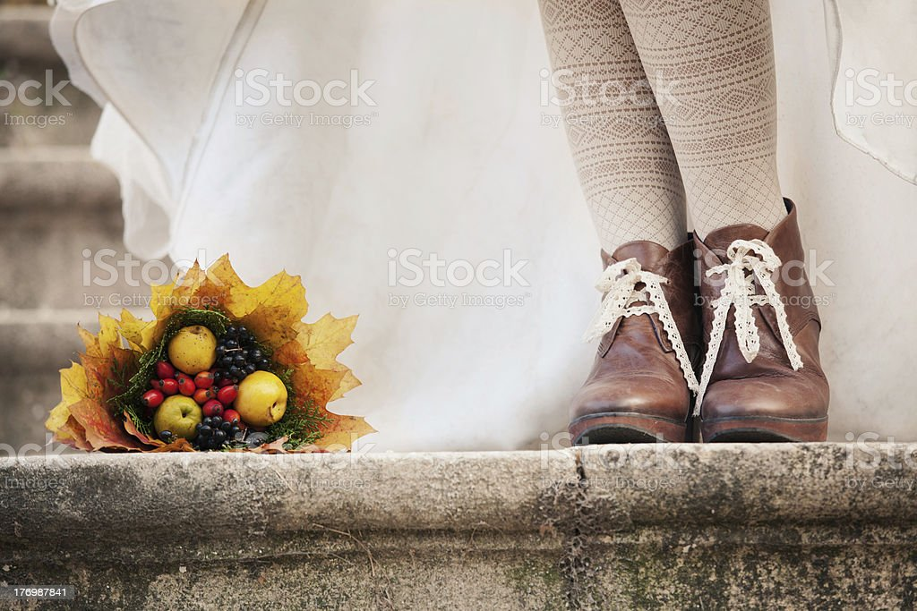 autumn bouquet and two women legs with leather boots royalty-free stock photo