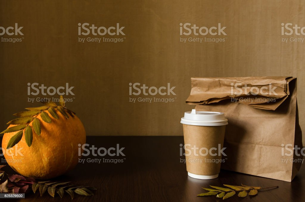 Autumn business lunch, still life with pumpkin and foliage stock photo