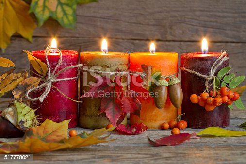 istock Autumn candles with leaves vintage abstract still life 517778021