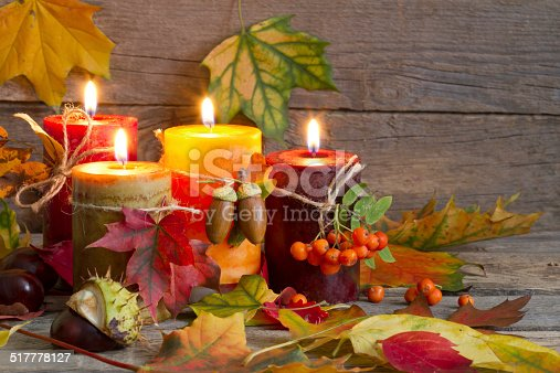 istock Autumn candles with leaves vintage abstract still life 517778127