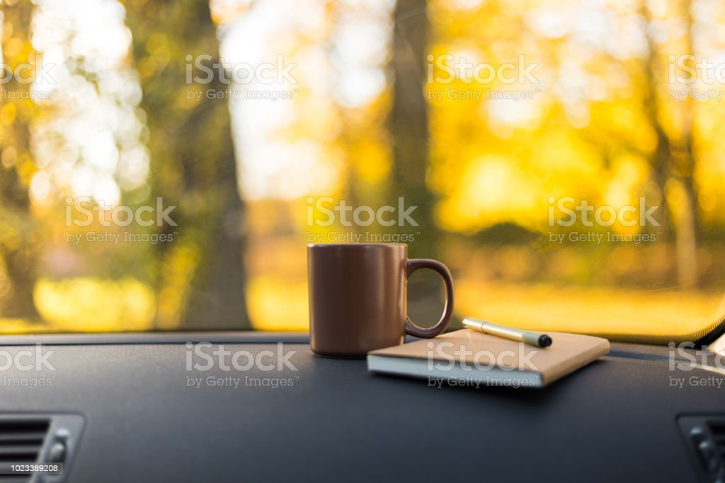 Autumn car trip. Craft notes and cup of tea in the car