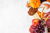 istock Autumn charcuterie side border against a white marble background 1276818358