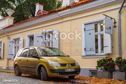 Tallinn / Estonia - October 31 2020: Renault Scenic parked in the cozy courtyard in the Old Town of Tallinn. Autumn cityscape.