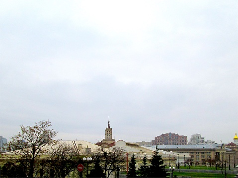 Autumn Cloudy Old City Center Buildings Skyline with a Golden Orthodox Cathedral Bell Tower