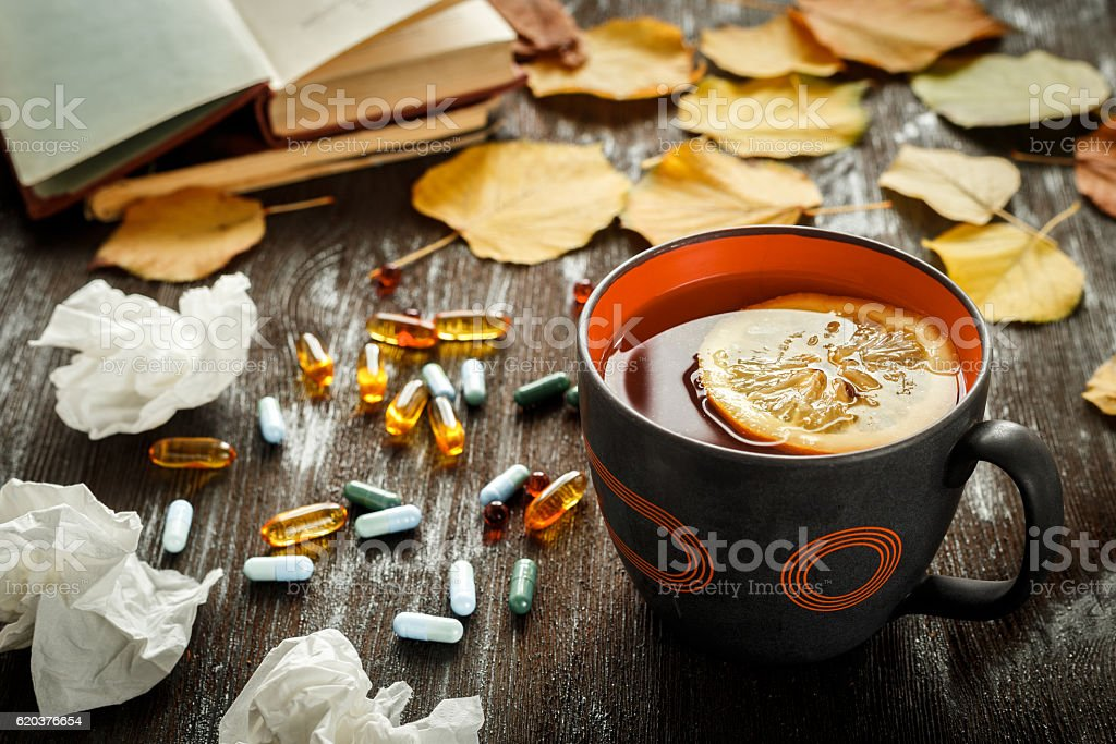 autumn cold - treatment with hot tea and medecine zbiór zdjęć royalty-free