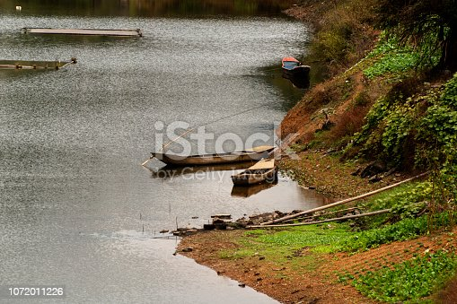 Autumn color: fishing boat on water