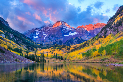 Maroon Bells and Maroon Lake - autumn colors at sunrise, near Aspen, Colorado, in the Elk Mountains.
