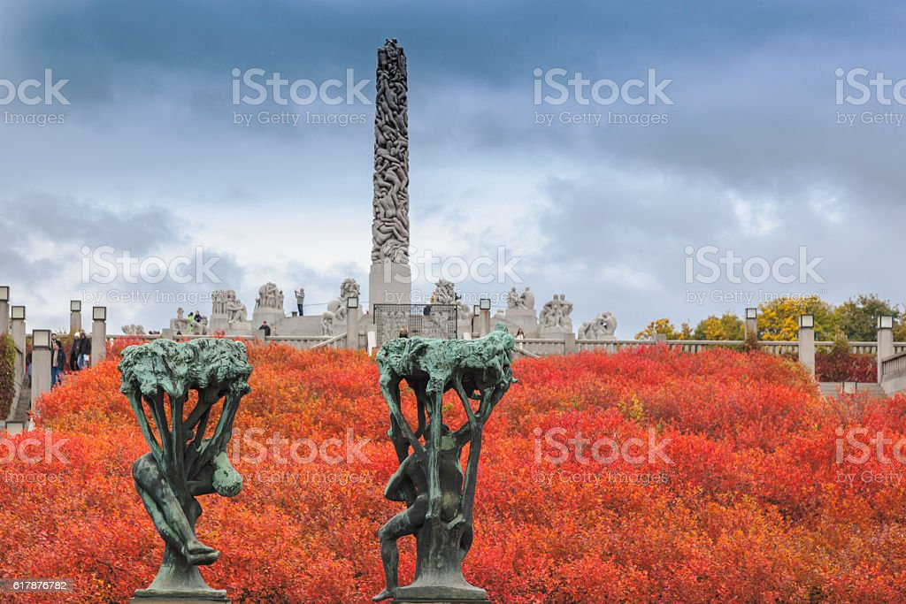 Autumn colors in Gustav Vigeland park  with the monolith sculpture. stock photo