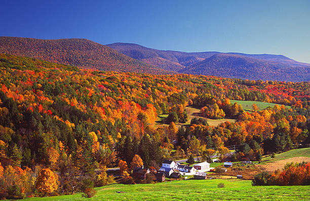 Autumn Colors Autumn foliage in the Bershire Hills region of Massachusetts. Photo taken from a scenic viewpoint of the Mount Greylock Range during the peak fall foliage season. The Berkshires region enjoys a vibrant tourism industry based on music, arts, and recreation. massachusetts stock pictures, royalty-free photos & images