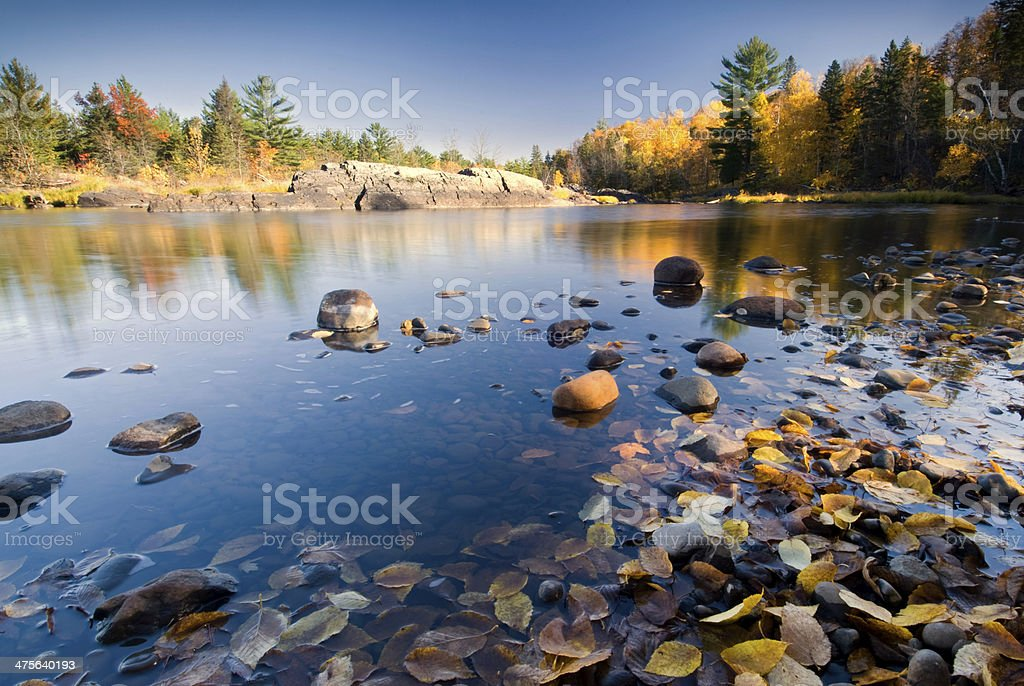 Autumn colors reflected in lake, Minnesota, USA stock photo