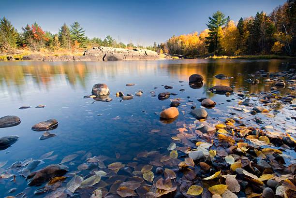 Autumn colors reflected in lake, Minnesota, USA stock photo