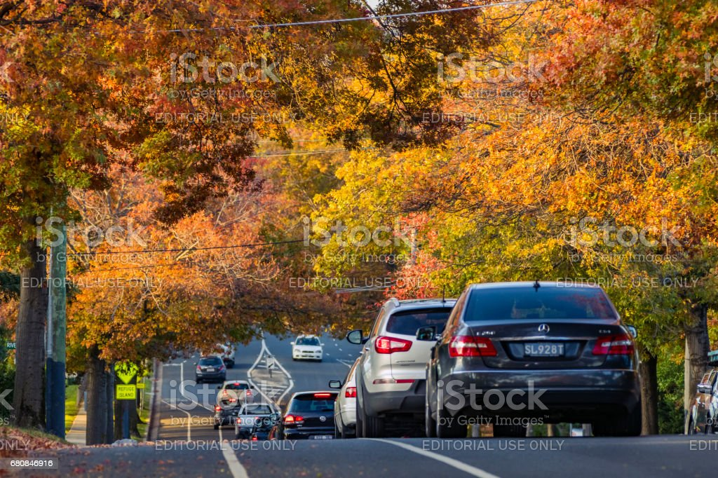 Autumn colours over rush hour traffic going downhill stock photo