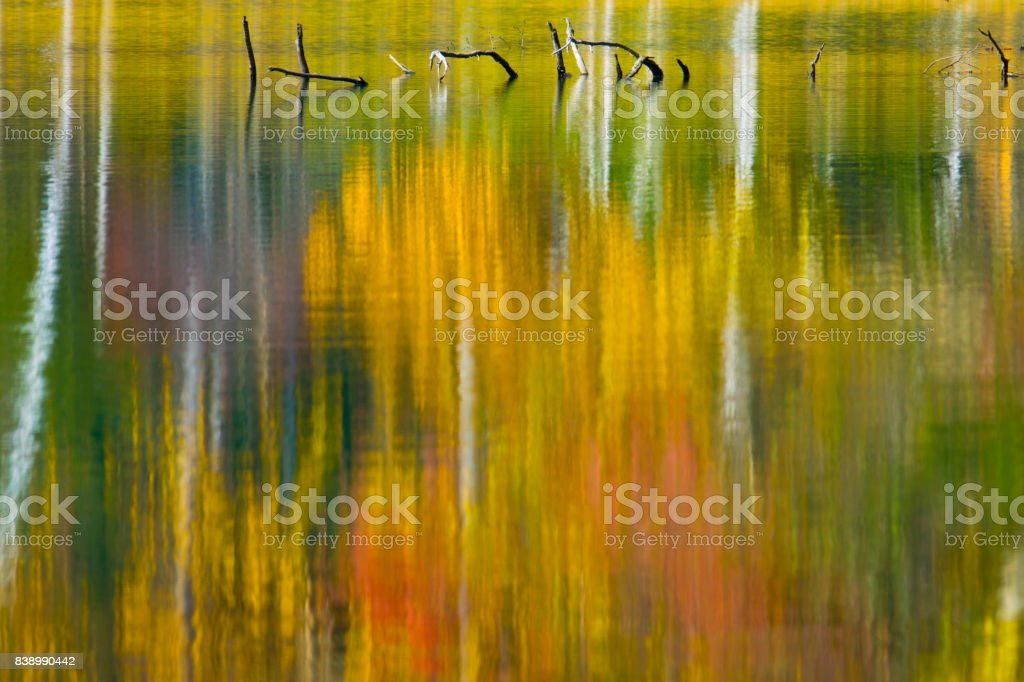 Autumn colours reflected in rippled lake stock photo