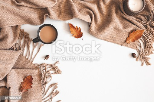 Autumn composition. Cup of coffee, plaid, autumn leaves on white background. Flat lay, top view, copy space