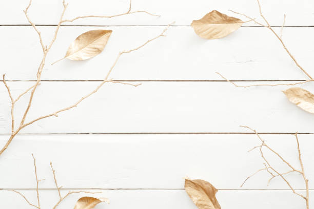 autumn composition. frame made of fall leaves and golden decorations on wooden white background. flat lay, top view, overhead. nordic, hygge, cozy home desk table concept. - hygge imagens e fotografias de stock