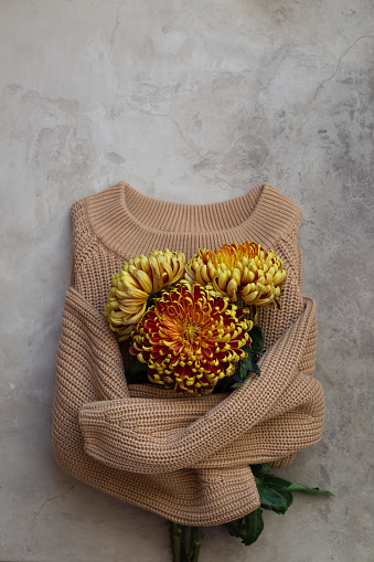Autumn composition. fresh flowers on stone background.  Flat lay with copy space