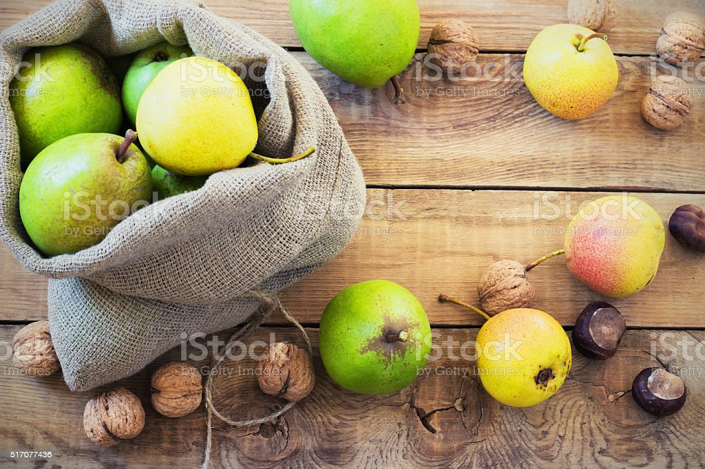 Autumn composition of fruits, nuts and spices - pears, walnuts stock photo