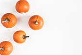 Autumn composition. Pumpkins on white background. Autumn, fall, halloween concept. Flat lay, top view, copy space