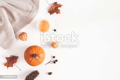 istock Autumn composition. Pumpkins, plaid, candles, dried leaves on white background. Autumn, fall, halloween concept. Flat lay, top view, copy space 1033889544