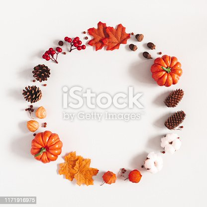 istock Autumn composition. Wreath made of pumpkins, flowers, leaves on gray background. Autumn, fall, halloween, thanksgiving day concept. Flat lay, top view, copy space, square 1171916975