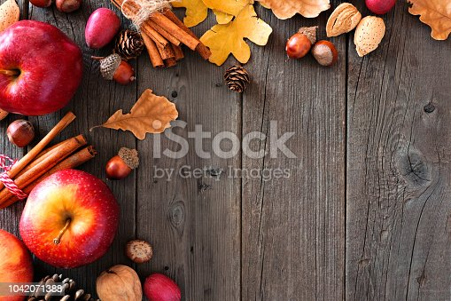1020586746istockphoto Autumn corner border of apples and fall ingredients over wood 1042071388