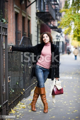 509923232 istock photo Autumn Day with Brunette Young Woman in New York City 173588866
