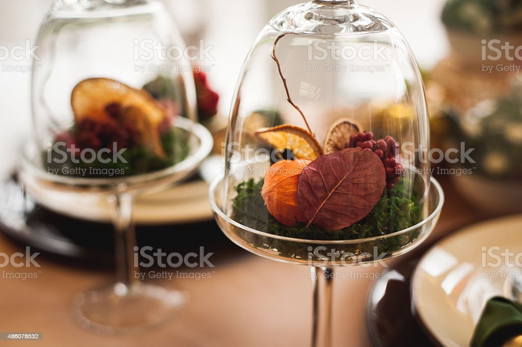 autumn decor with dry flowers and oranges stock photo
