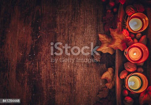 istock Autumn Decoration Background with Candles, Pumpkins, Leafs and Nuts 841254448
