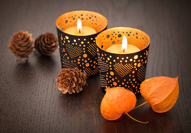 Autumn decoration with candle and Physalis alkekengi on wood Autumn decoration with candle and Physalis alkekengi on wood blotter stock pictures, royalty-free photos & images