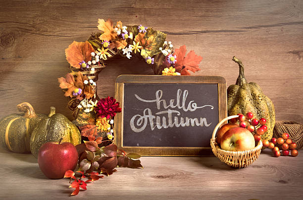 "autumn decorations amd ""hello autumn"" written on a blackboard - calligraphy photo pumpkins with leaves bildbanksfoton och bilder"