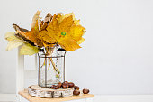 istock Autumn decorations with chestnut and maple leaves 1279528636