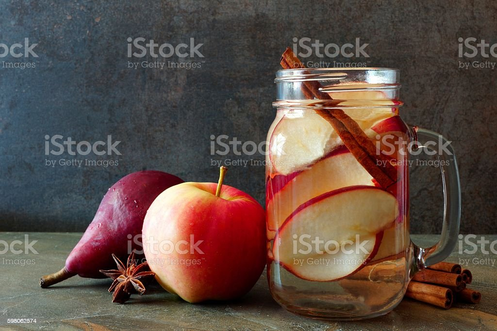 Autumn detox water in a mason jar with slate background stock photo