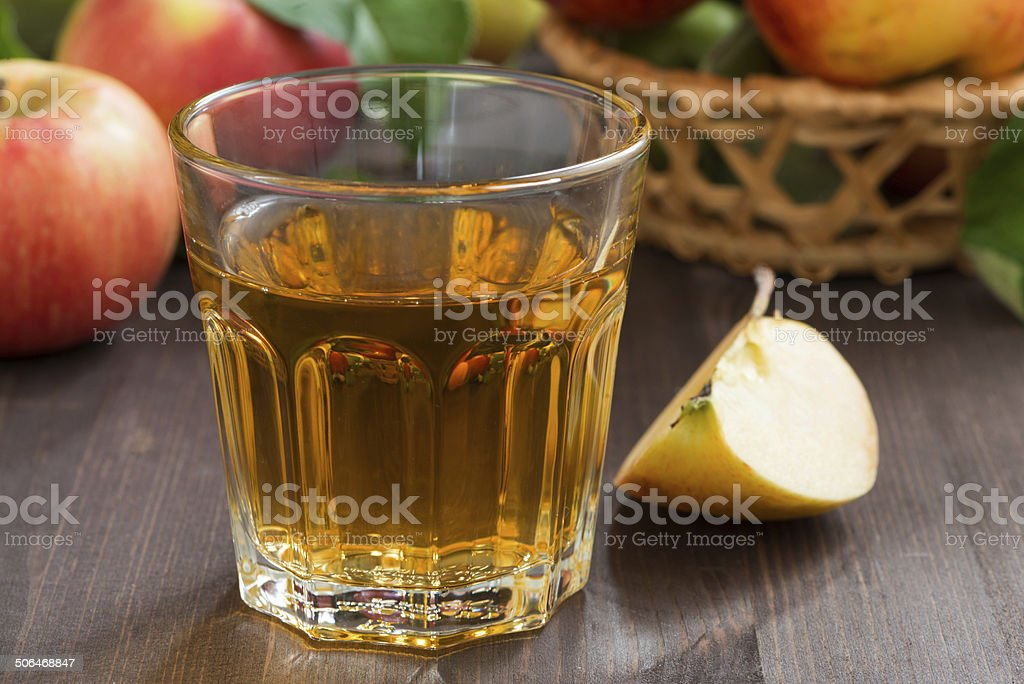autumn drink - apple cider or juice in a glass stock photo