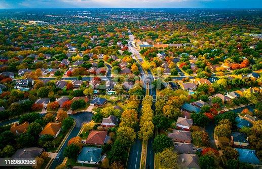 istock Autumn Fall Colors transforms landscape over Suburb modern housing development Birds Eye View 1189800956