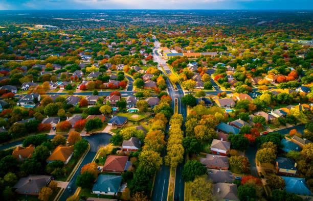 Autumn Fall Colors transforms landscape over Suburb modern housing development Birds Eye View stock photo