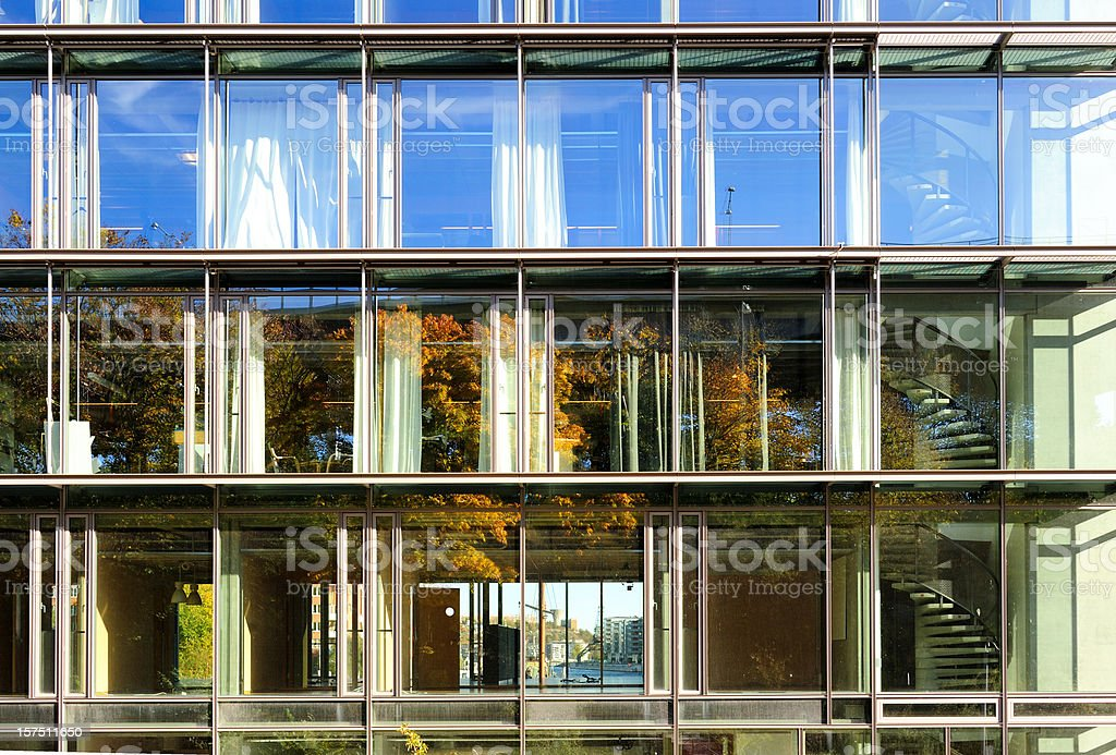 Autumn / Fall reflected in glass facade royalty-free stock photo