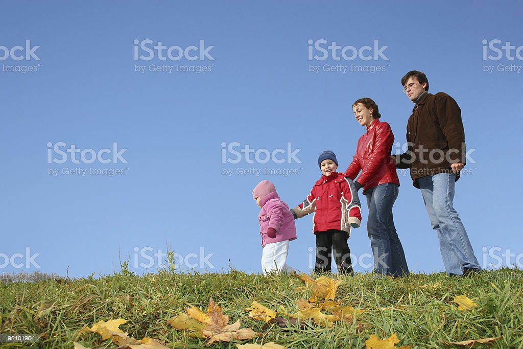 autumn family of four and CLEAR sky royalty-free stock photo
