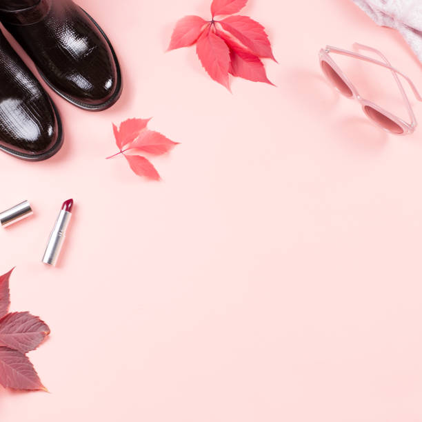 Autumn female clothes collection. Women fall fashion concept flat lay. Pink purse, pumps, scarf and cosmetics overhead stock photo