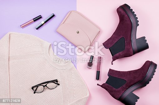 istock Autumn female clothing and accessories on pastel background. 877121628