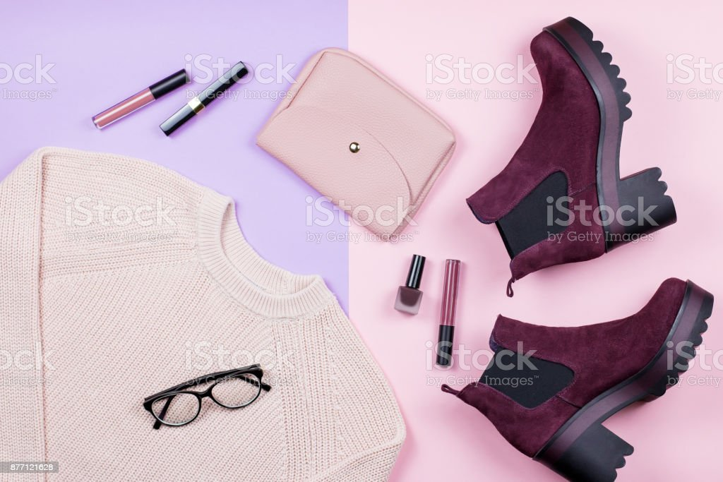 Autumn female clothing and accessories on pastel background. stock photo